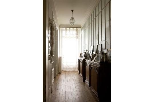A corridor along the light-filled bathroom