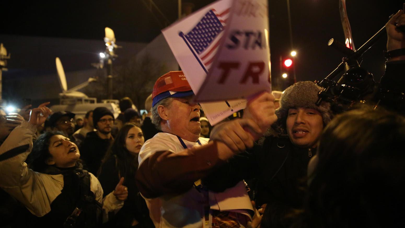 A protester celebrates