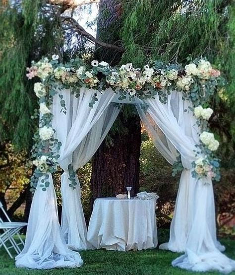Green and White Floral Outdoor Wedding Ceremony