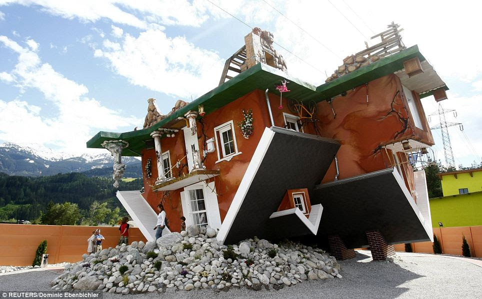 Tourist attraction: The upside down house took a painstaking eight months to build and furnish in Terfens, Austria