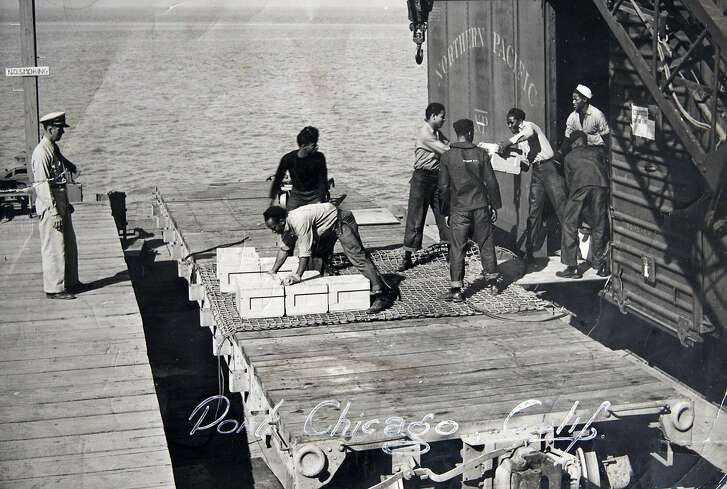 In this 1943 photo taken by a U.S. Navy photographer, and released by Percy Robinson in Los Angeles on Friday, July 20, 2007; Robinson, then 18 and a U.S. Navy Seaman First Class, is seen bending to load ammunition into a cargo net to be loaded aboard a ship in Port Chicago, Calif. During World War II some African-American sailors were working in a munitions factory in Port Chicago, Calif., under what they believed to be dangerous conditions. After an explosion at the site, some members of a work crew went on strike and were charged with mutiny. Sailor Percy worked there, and was involved in the work stoppage, but was not charged with mutiny. He received a summary court marshal, and was later charged with disobeying orders. (AP Photo/Percy Robinson) Ran on: 07-30-2007 Before the explosion, Navy workers loaded ammunition into a ship's cargo net at Port Chicago.