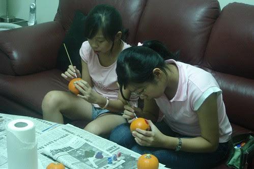Karen and Christine painting their pumpkins