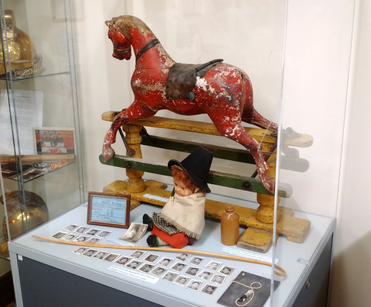 Display case at Blaenavon Community Museum showcasing the life of children