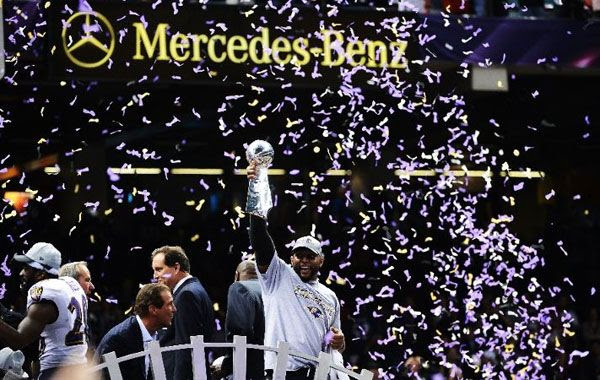 The Ravens' Ray Lewis celebrates with the Lombardi Trophy after his team won 34-31 against the San Francisco 49ers in Super Bowl XLVII, on February 3, 2013.
