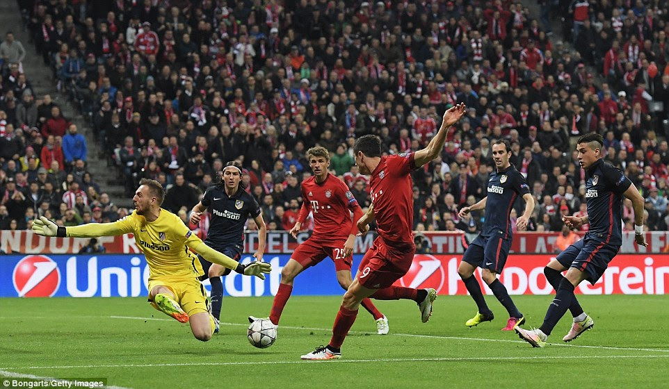 Bayern's Robert Lewandowski (right) was denied an opener in the first half after his effort was blocked by the Slovenia international