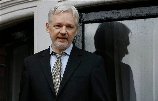 FILE - In this Friday Feb. 5, 2016 file photo, Wikileaks founder Julian Assange speaks from the balcony of the Ecuadorean Embassy in London. A Swedish court said Wednesday May 25, 2016, it has turned down a request to overturn the arrest warrant of WikiLeaks founder Julian Assange because Assange is still wanted for questioning in a case of suspected rape and there is a possibility he might evade prosecution. (AP Photo/Kirsty Wigglesworth, File)