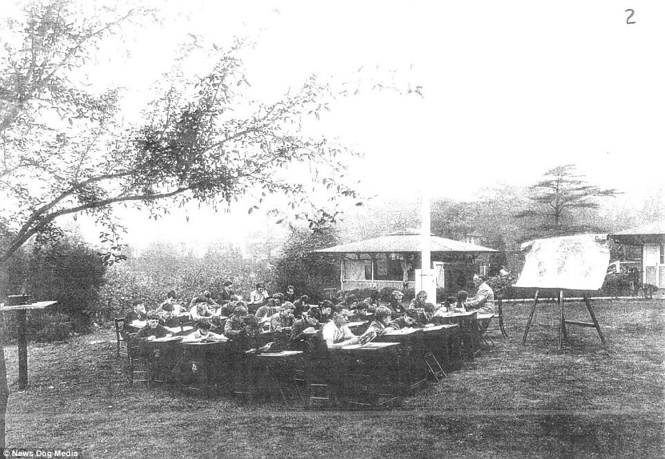 A class are captured being taught at the Charlton Park Open Air School in Charlton Park, London, circa 1910