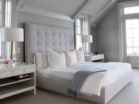 Bedroom Bliss: the simplicity of a tufted linen headboard. Interior Designer: Pembrooke & Ives.