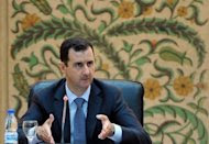 A picture released by the official Syrian Arab News Agency (SANA), shows President Bashar al-Assad addressing his new cabinet during a swear-in ceremony. Assad on Tuesday said his country was in a state of war and ordered his new cabinet to crush the anti-regime uprising as Turkey vowed to retaliate the downing of one of its jets. (AFP Photo/)