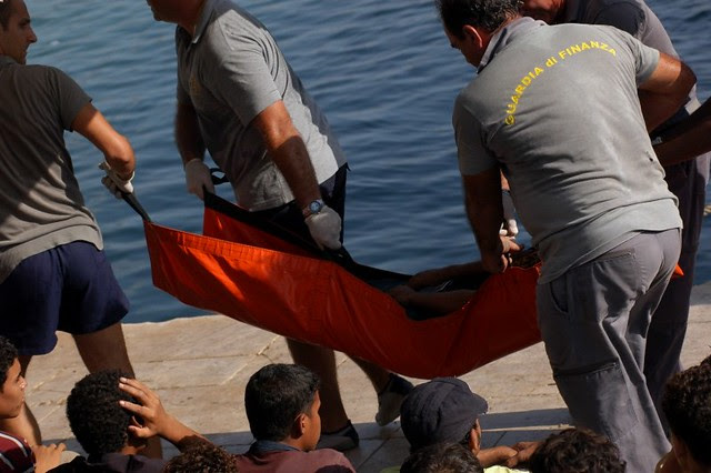 Victims of the disaster near Lampedusa taken away by the Guardia di Finanza