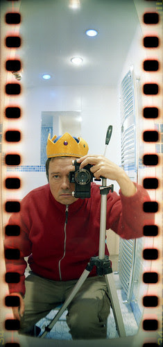 reflected self-portrait with Sprocket Rocket camera and yellow crown by pho-Tony