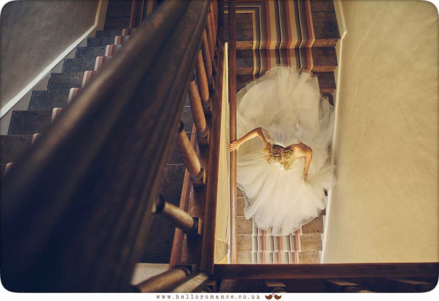 Stunning moment of bride on stairs - www.helloromance.co.uk