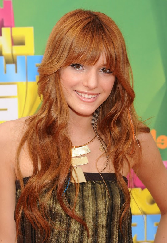 Bella Thorne Cute Long Curly Hairstyle with Face Framing Bangs for Girls | Styles Weekly