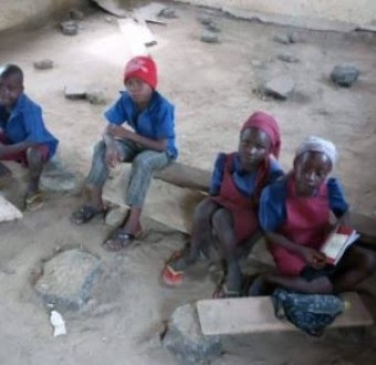 When we have children in schools such as this,what is government restructuring?