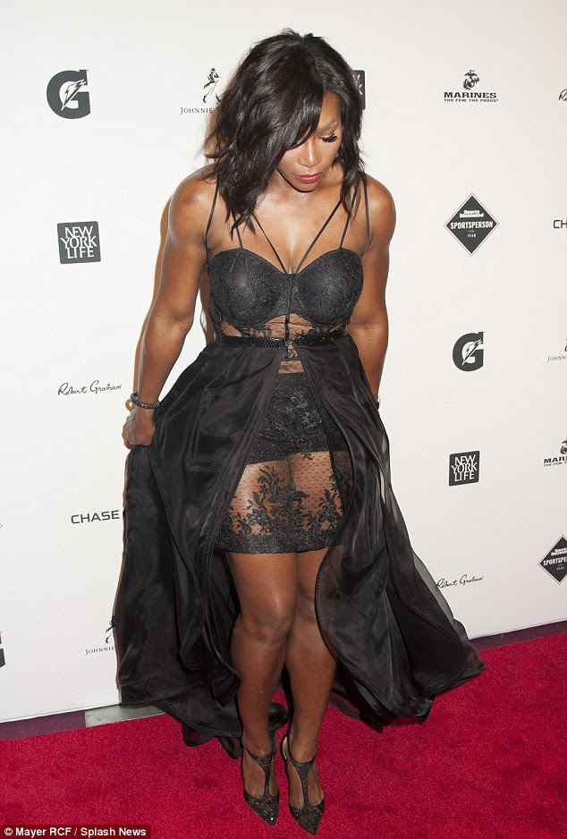 Scantily clad: Serena's lingerie-style frock featured a lace slip beneath a matching black chiffon maxi-skirt, which was open in the front