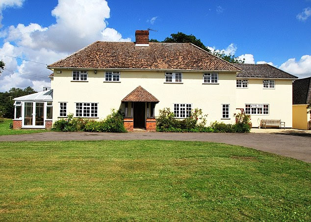 Saving the plane: Carolyn Grace has put her six-bedroom home, The Cangle in Halstead, Essex, on the market for £1.25 million to ensure the future for her Spitfire fighter aircraft is safe