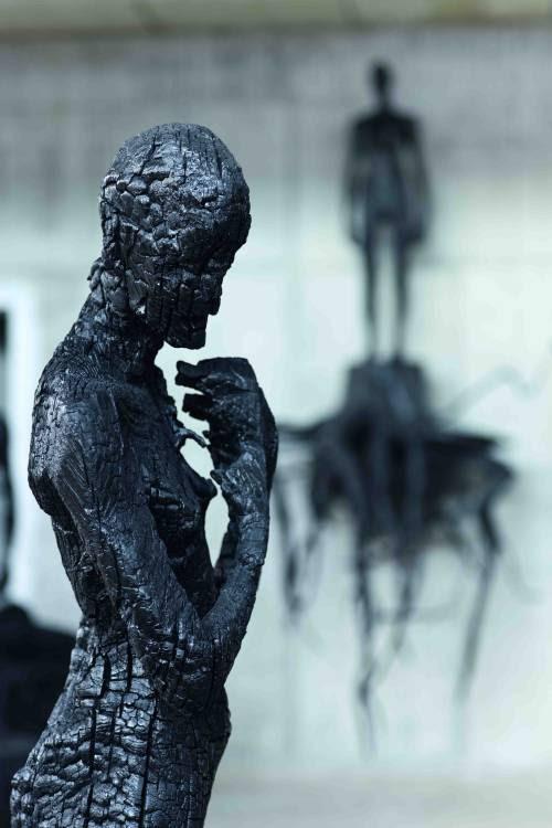 Charcoal sculptures byAron Demetz