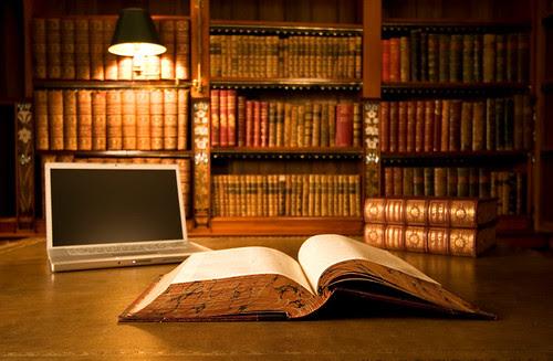 Laptop in classic library by vplsHoangSon