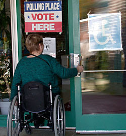 picture of person using a wheelchair entering polling place