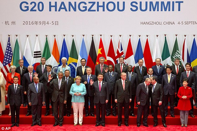 Theresa May (pictured on the left of the second row) found herself on the fringes of the G20's family photograph today after bruising comments from Barack Obama warning that the UK would not get a quick trade deal