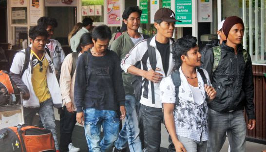 Fishermen arrive at Phnom Penh International Airport after being repatriated from East Timor, where they escaped from slave-like conditions aboard a Thai fishing boat.