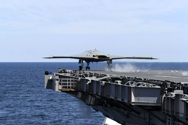The X-47B UCAV takes off from the flight deck of the USS George H.W. Bush for the first time, on May 14, 2013.