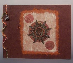 handmade photo album with sun image on the cover