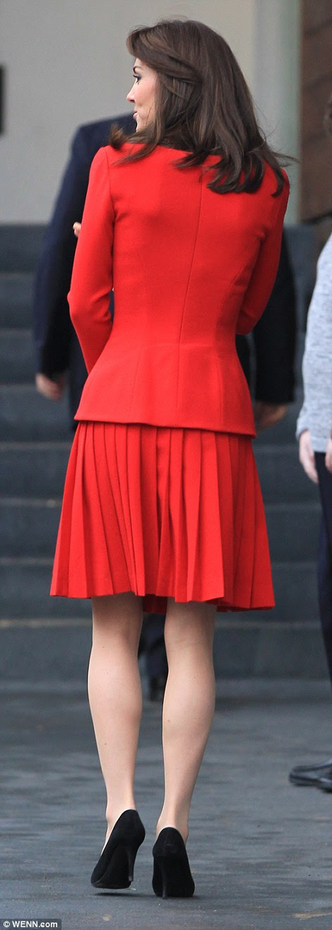 Clearly getting in the Christmas spirit, Kate stepped out in a bright red Alexander McQueen pleated dress that she has worn twice before