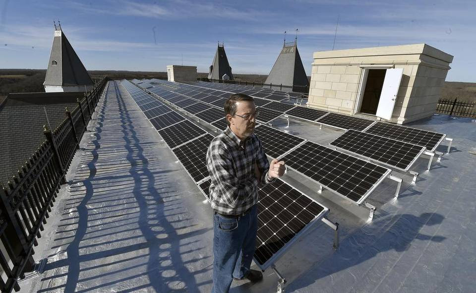 The roof of the main house contains a solar panel array that Steven T. Huff stand next to on the 72,000 square foot Chateau Pensmore under construction on Wednesday, December 10, 2015 near Highlandville, Mo.