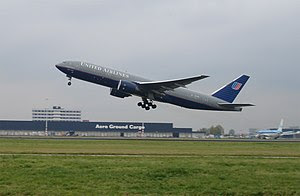 United Airlines Boeing 777-200 taking off at A...