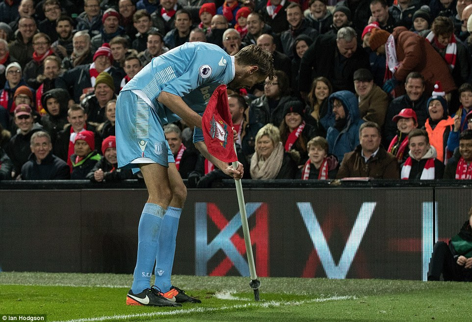 The former Liverpool striker then replaced the corner flag in its original position to the enjoyment of the watching fans