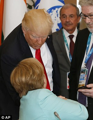 Donald Trump greets German Chancellor Angela Merkel as they attend a round table meeting of G7 leaders and Outreach partners at the Hotel San Domenico during a G7 summit in Taormina, Italy on Saturday, May 27