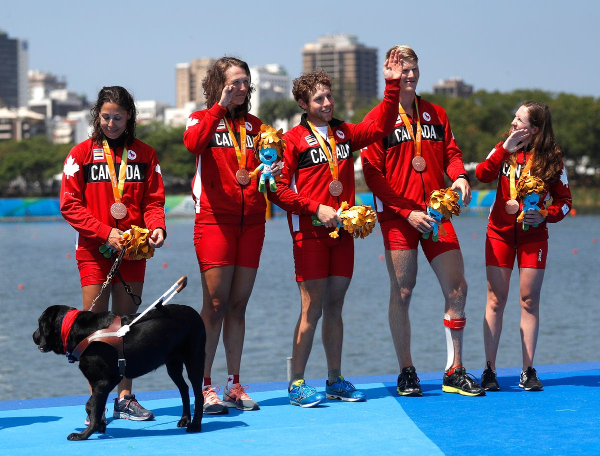 Members of Team Canada pose with their bronze medals in rowing.