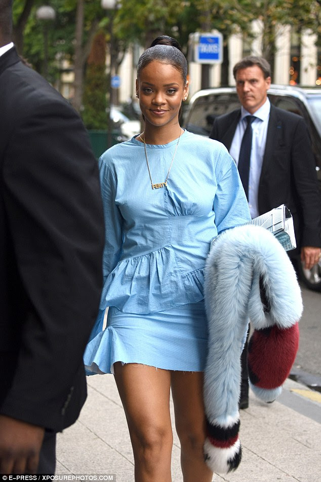 Ruffling no feathers! The Rude Boy singer's dress accentuated her lithe legs with a ruffle detail around her hips
