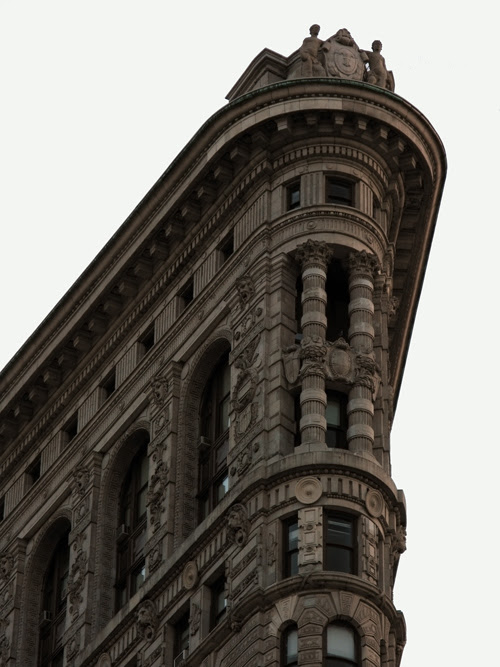 the top of the Flat Iron Building, Manhattan, NYC