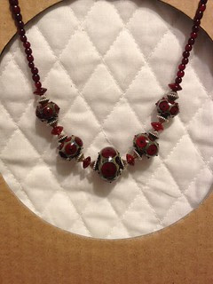 Red lampwork beads with horn, garnet, and silver beads
