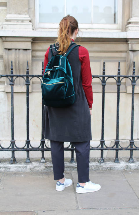 Laura wears: Backpack: Sandro, Trainers: Adidas, Dress worn as jacket: Cos, Top: Jaeger, Trousers: Public School for J Crew