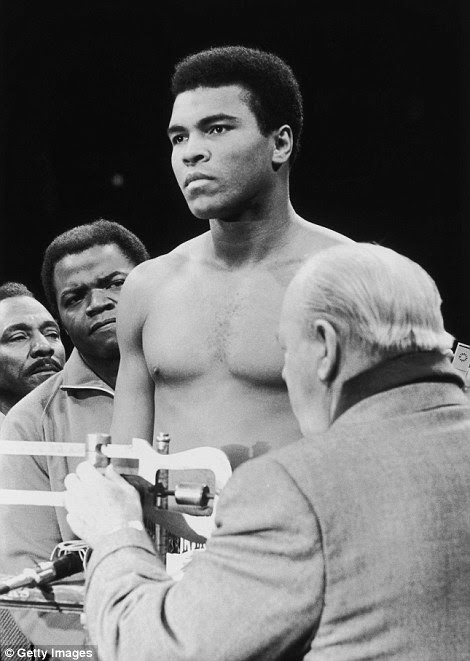 Ali gets weighed before a bout with Oscar Bonavena in 1971