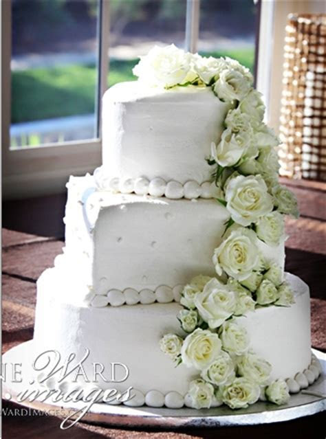 White wedding cake with cascading roses   Weddingbee Photo