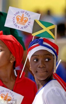 the monarchy is still widespread as this young girl with a Queen's Jubilee flag and the Jamaican National Flag