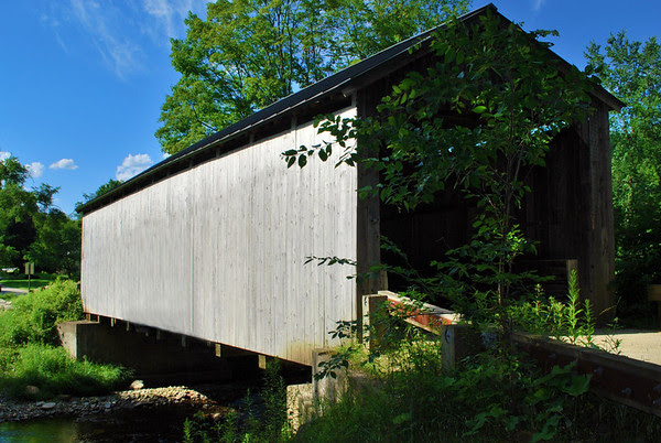 The Kidder Hill Covered Bridge is a single lane 67-foot Kingspost design built in 1870 that spans the South Branch of the Saxton River just south of Grafton Village.