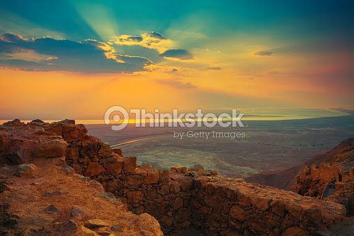 Beautiful Sun Rising Over Masada Fortress Stock Photo Thinkstock