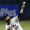 Houston Astros' Dallas Keuchel delivers a pitch against the Kansas City Royals in the first inning of a baseball game Tuesday, June 30, 2015, in Houston. (AP Photo/Pat Sullivan)