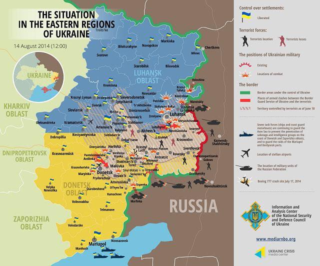 Decenas de vehículos militares pesados rusos se congregaron en Viernes, 15 de agosto 2014, cerca de la frontera con Ucrania, mientras que los guardias fronterizos ucranianos cruzaron la frontera para inspeccionar un enorme convoy de ayuda de Rusia. El convoy sigue esperando el permiso para llevar su carga a las ciudades en poder de los rebeldes pro-rusos en el este de Ucrania, que han sido azotados por la violencia.