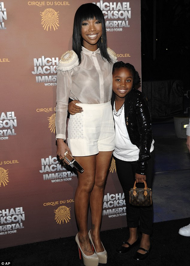 Fans: Singer and actress Brandy Norwood and her daughter Sy'rai Smith arrive