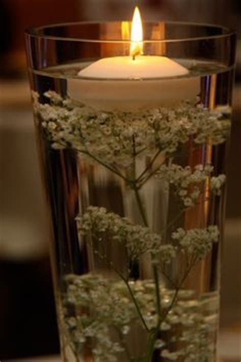 babys breath submerged in water centerpiece with or