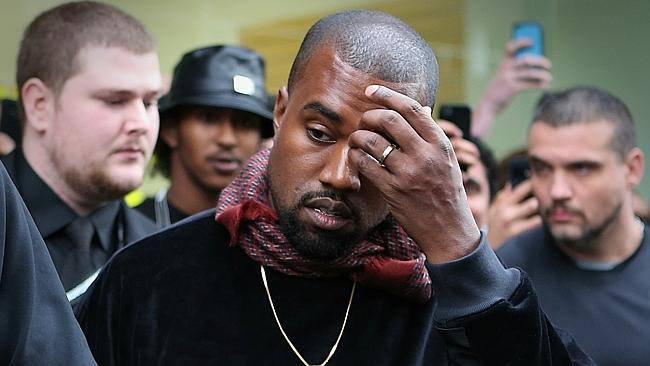 Kanye West appears unimpressed as they leave his pop-up shop in Chapel Street. Picture: M