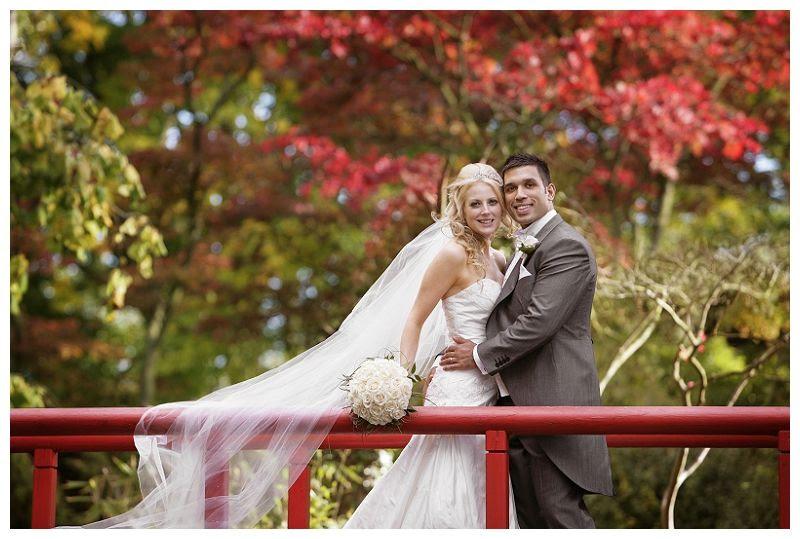 Weddings at Fanhams Hall 15, Wedding on bridge at Fanhams Hall