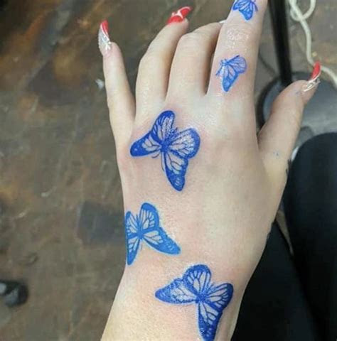blue butterfly tattoo hand butterfly hand