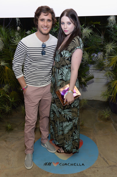 Actors Diego Boneta (L) and Michelle Trachtenberg attend the Official H&M Loves Coachella Party at the Parker Palm Springs on April 10, 2015 in Palm Springs, California.
